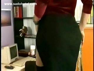 milf secretary slave is spanked in de office on her butt and bit in her nipples by her masked boss